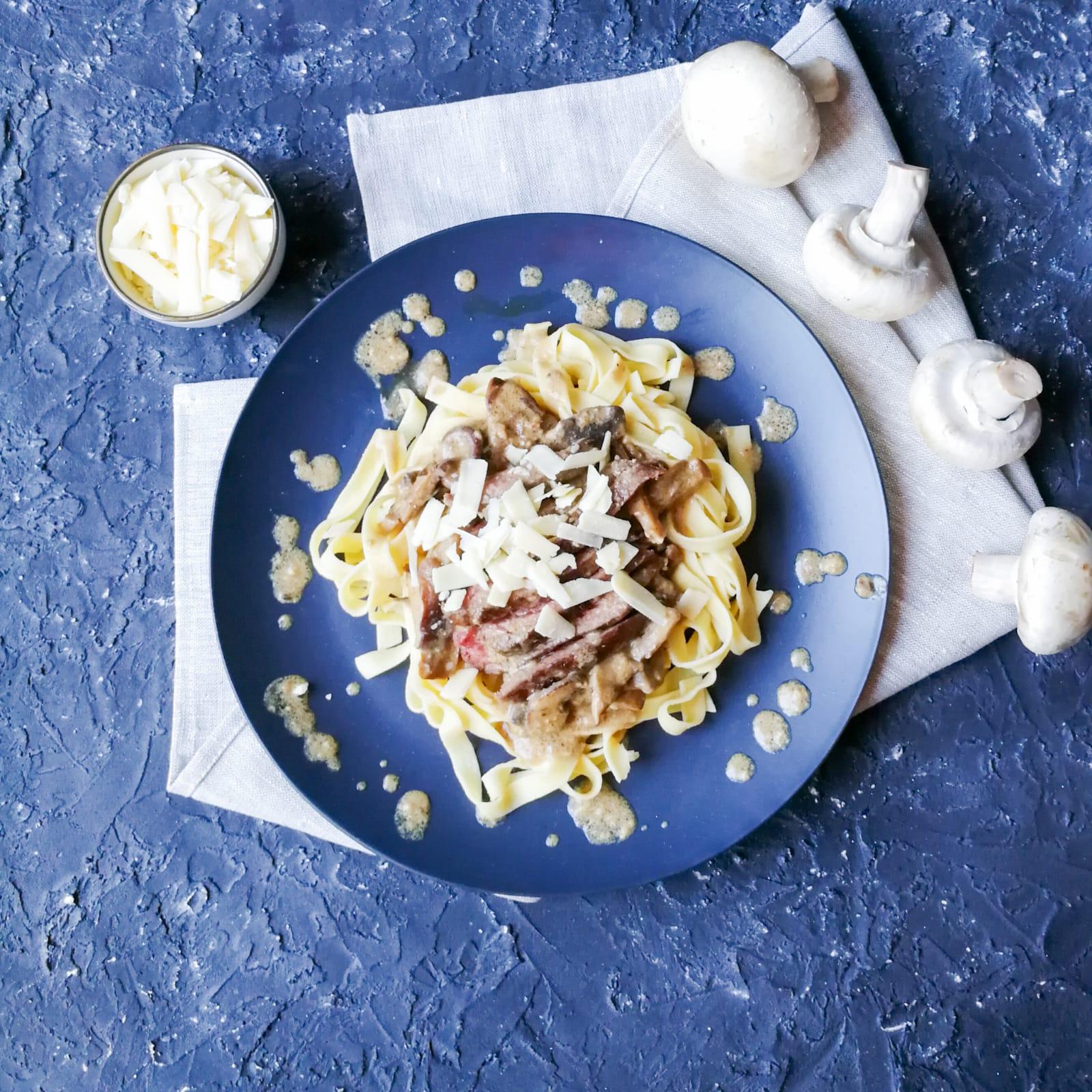 Tagliatelle met truffelchampignonsaus en biefstuk
