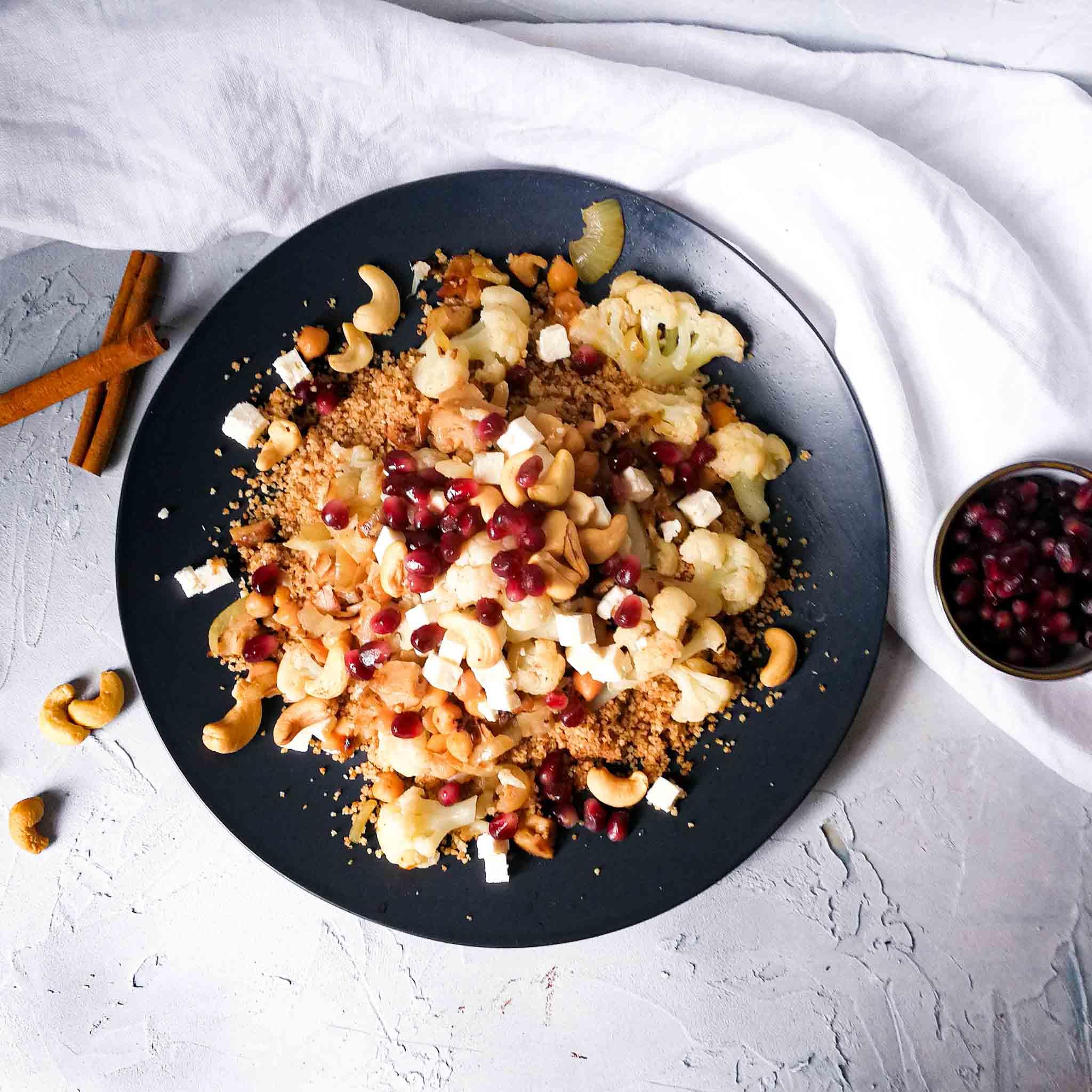 Couscous met baharat, bloemkool en granaatappel